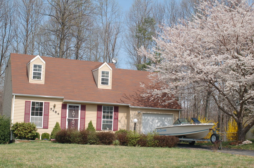 Our house with dogwood tree in bloom