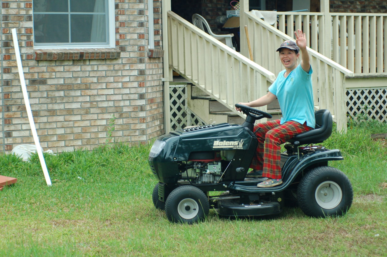 Second Photo - Winnie Driving the Lawn Mower