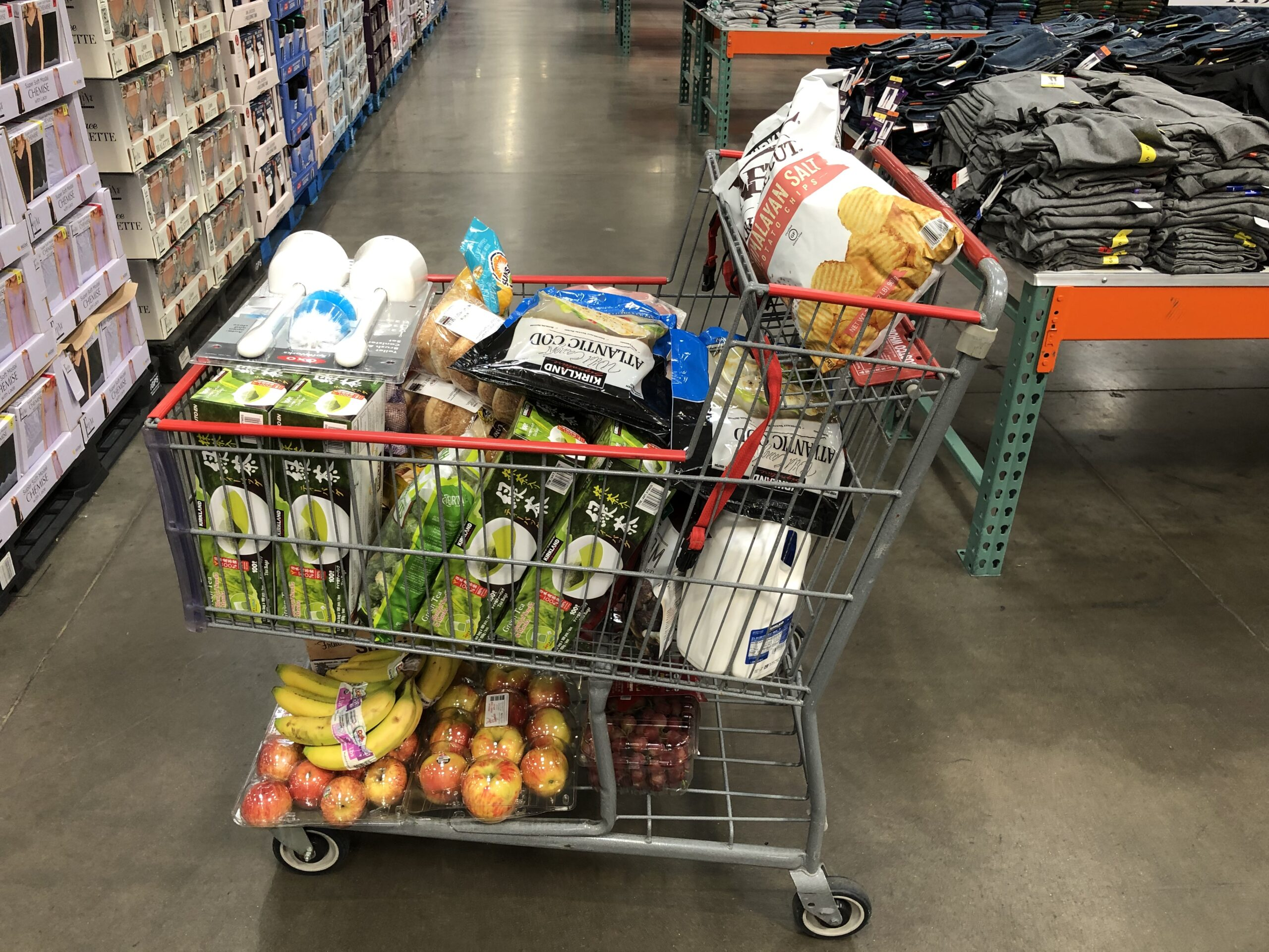 A Shopping Cart Filled With Groceries